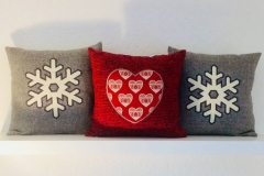 Cuscini con  cuori e fiocco di neve